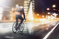 Cyclists ride through lighted city