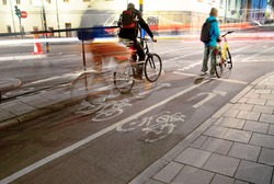 Cyclists waiting on their bikes at a crossing