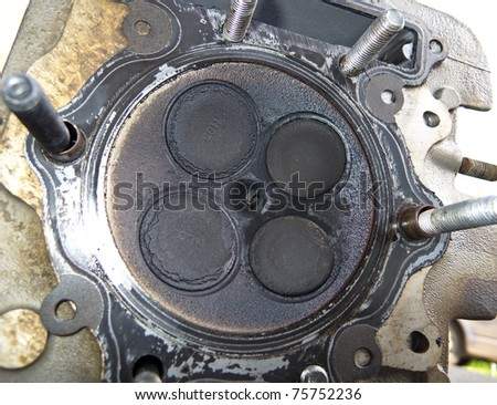 Cylinder head of a motorcycle engine with four valves