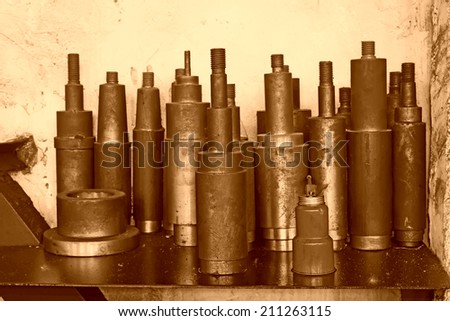 cylinder metal parts piled up together, closeup of photo