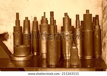 cylinder metal parts piled up together, closeup of photo