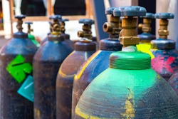 Cylinders with technical gases. Fragment of a cylinder with oxygen. Tanks for liquid oxygen. Production of gas bottles. Buy gaseous oxygen. Fuel equipment. Equipment for small production