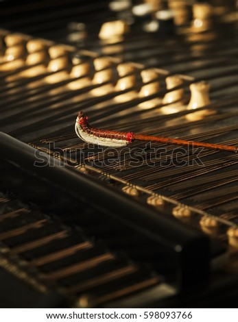 Cymbal,Cimbalom or Cembalon selective focus.Close up of  strings and wound beaters.The cimbalom is a concert hammered dulcimer,a type of chordophone. Cymbal is a very special string music instrument.  #598093766