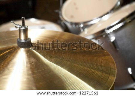 Cymbal closeup with drum set in background