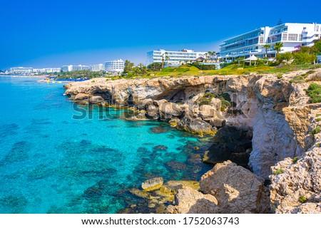 Cyprus. Ayia Napa Resort. Hotels off the coast. Blue Loguna in Cyprus. Rocky seashore. Relax in a resort hotel. Travels in Cyprus. Mediterranean Sea. Cavo Greco. Ayia Napa Resort Panorama. Stock fotó ©