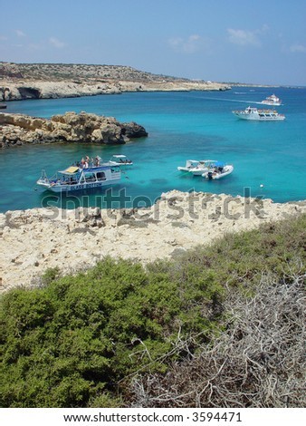 Cyprus coastline and tourboats