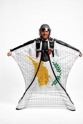 Cyprus flag travel. Bird Men in wing suit flag. Sky diving men in parashute. Patriotism, men and flag.