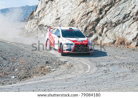 CYPRUS - NOVEMBER 7: Driver Michalis Poseidas (cy) and co-driver Phanos Christophi (cy) driving Mitsubishi Lancer Evo X During Fx Pro Cyprus Rally on November 7, 2010 in Limassol District, Cyprus.