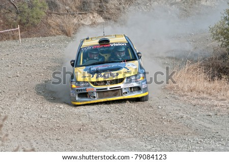 CYPRUS - NOVEMBER 7: Driver Panayiotis Yiangou (cy) and co-driver Stavros Avgousti (cy) driving Mitsubishi Lancer Evo IX During Fx Pro Cyprus Rally on November 7, 2010 in Limassol District, Cyprus.