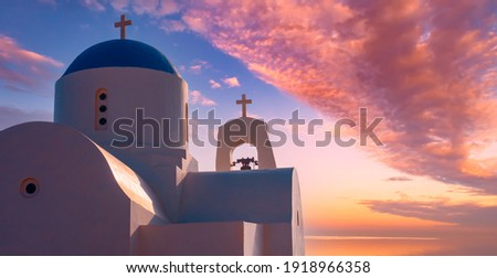 Cyprus. Protaras. Pernera. Fragment of the Church of St. Nicholas in Cyprus. Bell tower of the white Church with blue domes. Orthodox Church on the Mediterranean coast. Christianity.