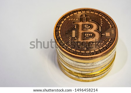 cyripto money mining.Bitcoin is a digital asset designed to work in peer-to-peer transactions as a currency. close up physical bitcoin coins on white background. #1496458214