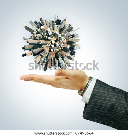 Cyti world on businessman hand - stock photo