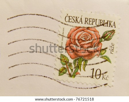 CZECH REPUBLIC - CIRCA 2009: A post stamp printed in Czech Republic and showing a red or pink rose (rosa rosa) flower, series, circa 2009.