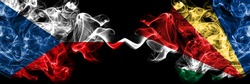 Czech Republic, Czech vs Seychelles, Seychellois smoky mystic flags placed side by side. Thick colored silky abstract smoke flags.
