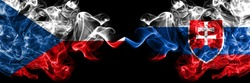 Czech Republic, Czech vs Slovakia, Slovakian smoky mystic flags placed side by side. Thick colored silky abstract smoke flags.