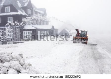Czech Republic - mountains Krkonose - snowblower on road