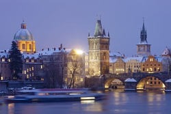 czech republic prague - charles bridge and spires of the old town at dusk