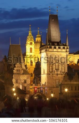 czech republic prague - charles bridge tower and st. nicolas church at dusk
