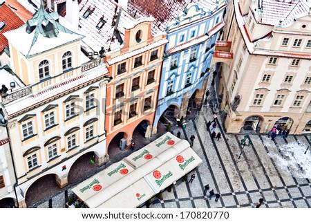 CZECH REPUBLIC, PRAGUE - JANUARY 28: Tourists on famous Old Town square (a. k. a. Staromestska) on January 28, 2013 in Prague, Czech Republic