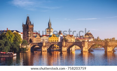 Czech Republic, Prague panorama with historic Charles Bridge and Vltava river - Shutterstock ID 758203759