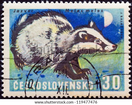 "CZECHOSLOVAKIA - CIRCA 1966: A stamp printed in Czechoslovakia from the ""Game Animals"" issue shows a Eurasian badger (Meles meles), circa 1966."