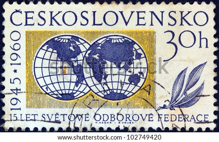 CZECHOSLOVAKIA - CIRCA 1960: A stamp printed in Czechoslovakia issued for the 15th anniversary of W.F.T.U shows two globes, circa 1960.