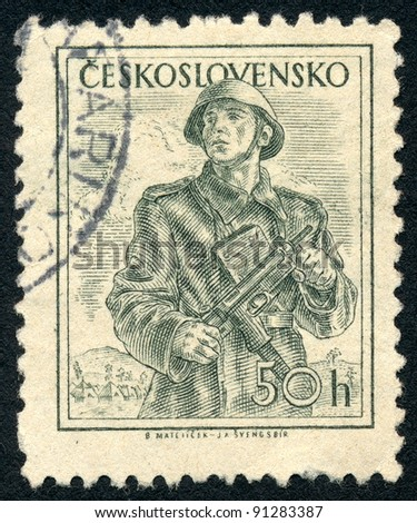 CZECHOSLOVAKIA - CIRCA 1954: A stamp printed in Czechoslovakia, shows soldier with a gun, series, circa 1954