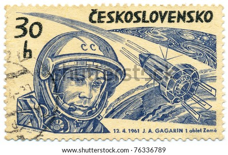 "CZECHOSLOVAKIA - CIRCA 1964: A stamp printed in Czechoslovakia, shows Yuri Gagarin and Soviet spaceship ""VOSTOK-1"", circa 1964"