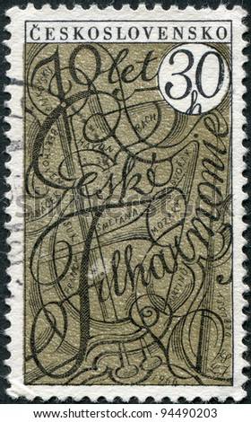 CZECHOSLOVAKIA - CIRCA 1966: A stamp printed in the Czechoslovakia, is dedicated to the 70th anniversary of the Czech Philharmonic, show Symbolic Musical Instruments and Names of Composers, circa 1966