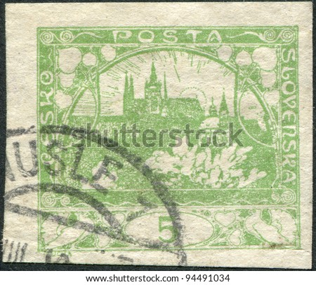 CZECHOSLOVAKIA - CIRCA 1918: A stamp printed in the Czechoslovakia, shown Hradchany (St. Vitus Cathedral) and St. Nicholas Church, Prague, circa 1918