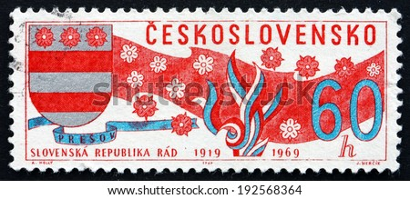 CZECHOSLOVAKIA - CIRCA 1969: a stamp printed in the Czechoslovakia shows Arms of Slovakia, Banner and Blossoms, circa 1969