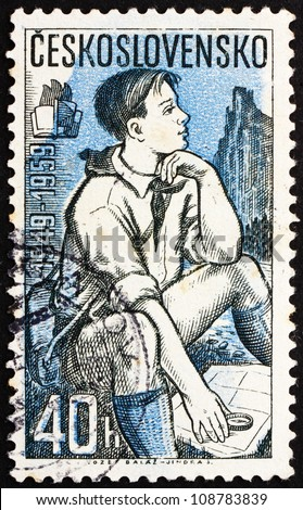CZECHOSLOVAKIA - CIRCA 1959: a stamp printed in the Czechoslovakia shows Pioneer Studying Map, circa 1959
