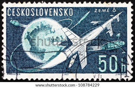 CZECHOSLOVAKIA - CIRCA 1963: a stamp printed in the Czechoslovakia shows Rockets and Sputniks Leaving Earth,  circa 1963