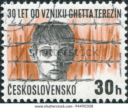 CZECHOSLOVAKIA - CIRCA 1972: A stamp printed in the Czechoslovakia, shows the Terezin concentration camp, Boy's head behind barbed wire, circa 1972