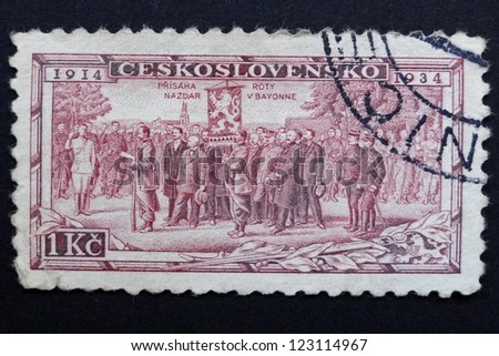 CZECHOSLOVAKIA - CIRCA 1934: Stamp printed in former Czechoslovakia commemorates 20th anniversary of Czechoslovak Foreign Legions, French battalion enrolling at Bayonne, circa 1934