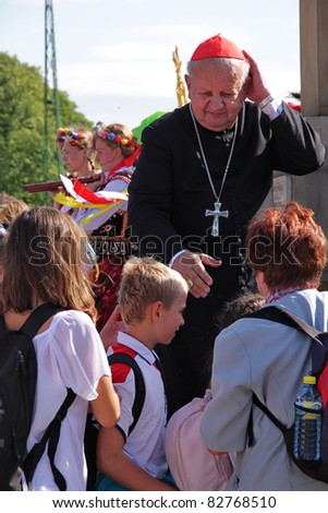 CZESTOCHOWA, POLAND - AUG 11 : Cardinal Stanislaw Dziwisz greets the unidentified pilgrims arriving in the Jasna Gora Sanctuary on august 11, 2011 in Czestochowa, Poland