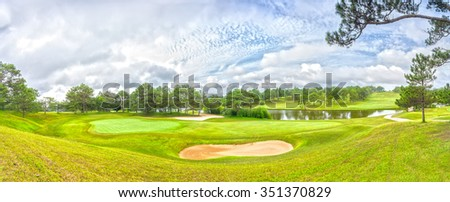 Da lat panoramic golf course with grass, pine forest, interwoven, far away from the lakes create picture wearing to greet a new day in the highlands of Dalat, Vietnam.
