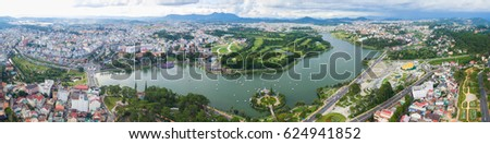 Da Lat, Vietnam - June 03, 2016 : Aerial view of Da Lat city, Vietnam. It is centered around a lake and golf course, and surrounded by hills, pine forests, lakes and waterfalls #624941852