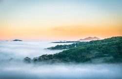 Da Lat, Vietnam, sun rise on mountain in fog