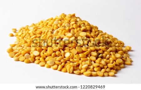 Daal Chana, Heap of yellow split chickpeas on white background, Indian or pakistani raw food.