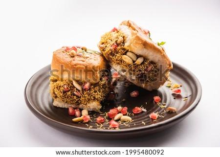 Dabeli, kutchi dabeli or double roti is a popular snack food of India, originating in the Kutch or Kachchh region of Gujarat Сток-фото ©