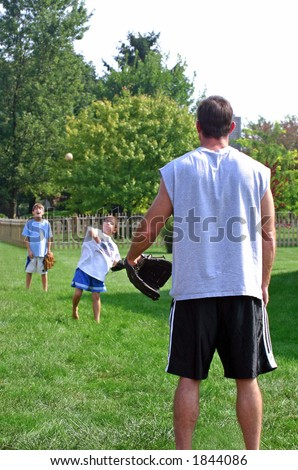 Dad and Boys Playing Catch
