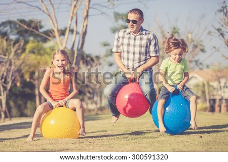 Dad and children playing on the lawn in front of house at the day time #300591320