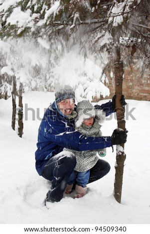 Dad and daughter in the park in winter