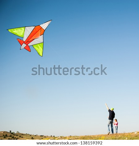 Dad and his little daughter flying a kite. Family Vacation