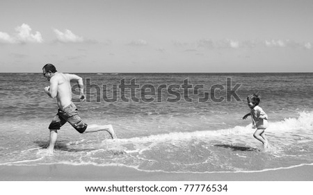 Dad and son at sea, black and white photo