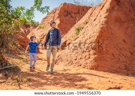Dad and son tourists in red canyon, resumption of tourism concept. Traveling with children concept Stock photo ©