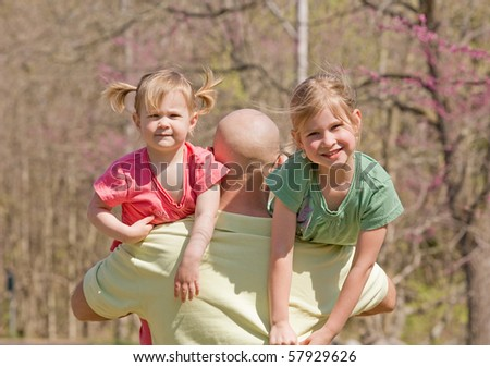 Dad Carrying His Daughters