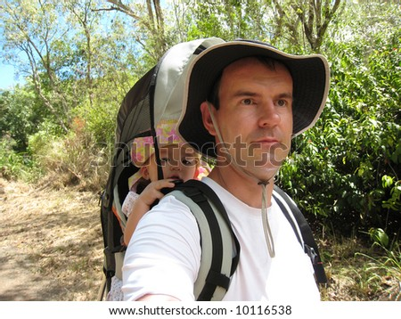 Dad hiking with baby daughter