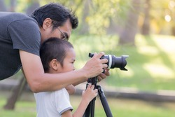 Dad is teaching photography to his son